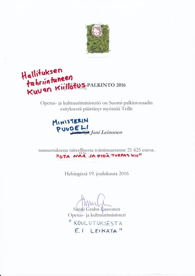 Ja näin. Parilla sanalla ministeriön myöntämä Suomi-palkinto muuttui ministerin ja ministeriön työtä kritisoivaksi taideteokseksi.
