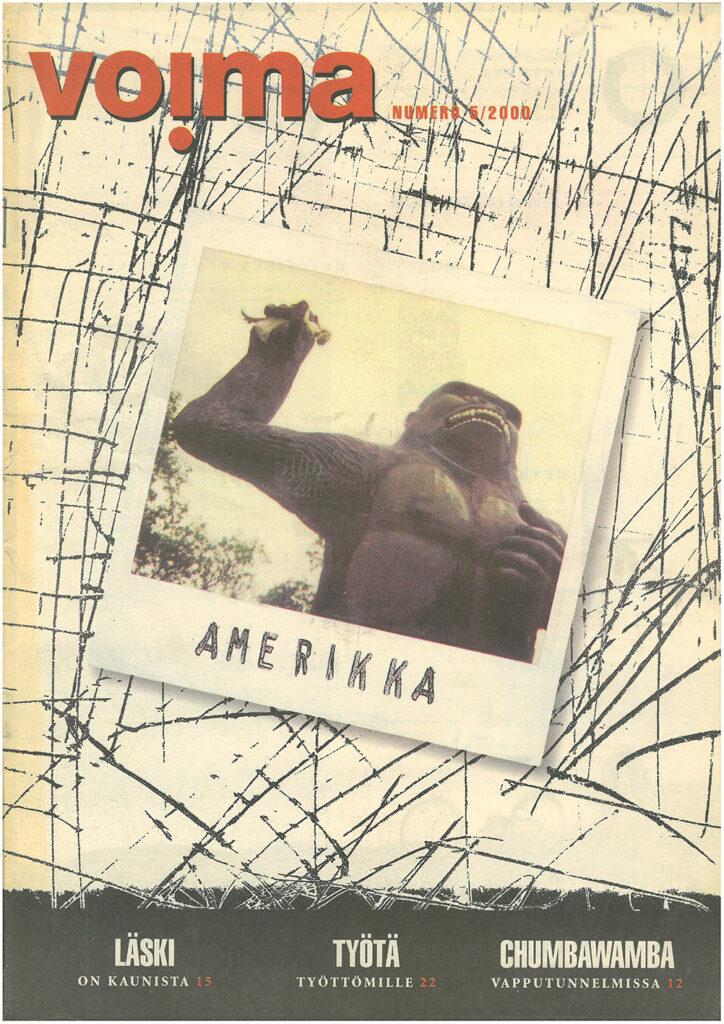 """Lehden kannessa polaroid-kuva gorillapatsaasta, joka pitelee käsissään nukkea. Teksti """"Amerikka"""" polaroidin alakulmassa."""